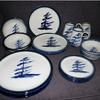 Windswept Pine in Blue with blue and green rim  Dinnerware   4 piece place setting includes dinner plate and a mug the other 2 pieces may be 2 bowls, 2 plates or combination $135 or choose a  set of bowls or dessert plates