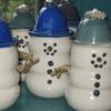 Snowman oil lamps Burns 99% paraffin oil available at Michael's, Hobby Lobby and Ace Hardware as well as Chatham Pottery oil burning snowmen $49